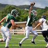 Record-Eagle/Jan-Michael Stump<br /> Traverse City West quarterback Donny Cizak (7) throws a touchdown pass to Dustin Tucker (9)(not pictured) in the first quarter of Saturday's game against Gaylord at Thirlby Field.
