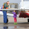 Record-Eagle/Jan-Michael Stump<br /> Kelsey Stobb, 4, of Holland talks to Wings of Mercy pilot Randy Kitzman of Traverse City following her plane ride during the 6th annual Wings of Mercy Fly-In Benefit Saturday at Cherry Capital Aviation, which included a pancake breakfast and the chance to fly with some of the pilots, who provide free air transport to distant medical facilities for people who need treatment but have limited financial means. Money raised at the event goes to offset fuel costs, which currently runs around $6.90 a gallon. Six Wings of Mercy pilots and their planes were on hand, as well as Northflight EMS and representatives from Coast Guard Air Station Traverse City. The organization has flown about 3,000 flights over the past 20 years.