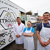 Record-Eagle/Dan Nielsen<br /> Co-owner Daniel Fuller, left, worker Katie Fink, center, and co-owner Austin Groesser outside the Nitrology food truck at The Little Fleet.