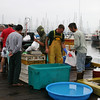 Fishermen in action selling their fish and crab.