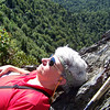 Jeane takes a brief nap on the warm rocks while Patti messes around.