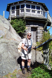 As we head back down the trail, Jeane stops to read the interpretive sign, which tells us the fire tower was built by the CCC in 1937.