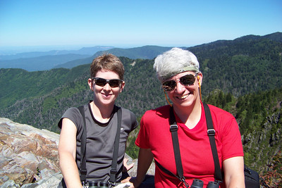 Jeane finally leaves her warm rocks to join Patti, and a fellow hiker takes our picture.