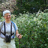 Jeane poses in front of the natural flower garden where so many butterflies are feeding.