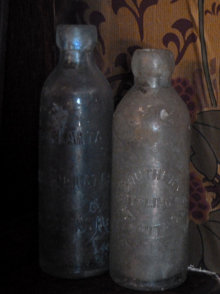 Original Coca Cola bottles from Joel Chandler Harris' time before they were shaped into their famous contour bottle design.