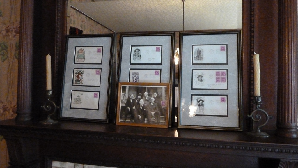 Joel Chandler Harris' First Day of Issue Stamps along with a photo of his children located in the dining room.