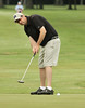 John Ransford watches his putt during the Saginaw District Golf Association Tournament qualifier Sunday at Green Acres Golf Course, Bridgeport.