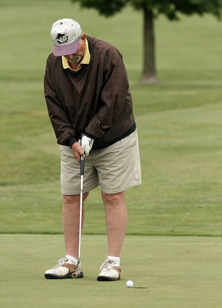 David Coy with a short putt on the 18th green during the Saginaw District Golf Association Tournament qualifier Sunday at Green Acres Golf Course, Bridgeport.