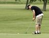 Mark James putts during the Saginaw District Golf Association Tournament qualifier Sunday at Green Acres Golf Course, Bridgeport.