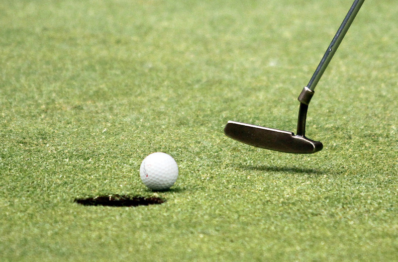A short putt is about to fall into the cup during the Saginaw District Golf Association Tournament qualifier Sunday at Green Acres Golf Course, Bridgeport.