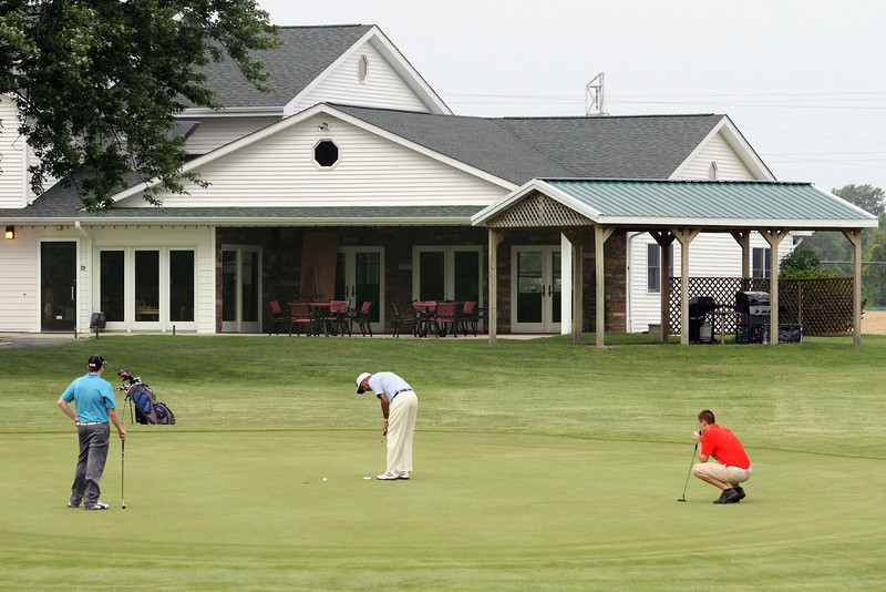 A group finishes their putts on the 9th green during the Saginaw District Golf Association Tournament qualifier Sunday at Green Acres Golf Course, Bridgeport.<br /> 2A tee off.