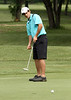 Drew Yntema watches his putt during  the Saginaw District Golf Association Tournament qualifier Sunday at Green Acres Golf Course, Bridgeport.