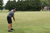 Chris Mellon putts from a distance during the Saginaw District Golf Association Tournament qualifier Sunday at Green Acres Golf Course, Bridgeport.