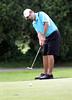 Drew Yntema watches his putt during  the Saginaw District Golf Association Tournament qualifier Sunday at Green Acres Golf Course, Bridgeport.