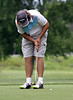 Hunter Koch watches a putt drop into the cup during the Saginaw District Golf Association Tournament qualifier Sunday at Green Acres Golf Course, Bridgeport.
