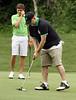 Mark James taps in a short putt during the Saginaw District Golf Association Tournament qualifier Sunday at Green Acres Golf Course, Bridgeport.