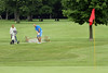 Jason Trumble chips on to the 18th green during the Saginaw District Golf Association Tournament qualifier Sunday at Green Acres Golf Course, Bridgeport.