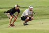 Nick Adams, right, receives help to line up a putt during the Saginaw District Golf Association Tournament qualifier Sunday at Green Acres Golf Course, Bridgeport.