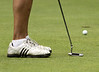Herb Spence III's putt rolls toward the cup during the Saginaw District Golf Association Tournament qualifier Sunday at Green Acres Golf Course, Bridgeport.