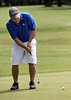 Tim Murlick putts during the Saginaw District Golf Association Tournament qualifier Sunday at Green Acres Golf Course, Bridgeport.