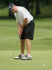 Max Williamson watches his putt drop into the cup during the Saginaw District Golf Association Tournament qualifier Sunday at Green Acres Golf Course, Bridgeport.