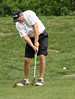 Max Williamson chips from the rough during the Saginaw District Golf Association Tournament qualifier Sunday at Green Acres Golf Course, Bridgeport.