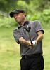 Chris Mellon watches his drive during the Saginaw District Golf Association Tournament qualifier Sunday at Green Acres Golf Course, Bridgeport.