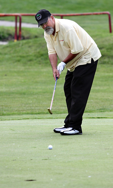 Mike Godard watches his putt and follows it all the way in to the cup during the Saginaw District Golf Association Tournament qualifier Sunday at Green Acres Golf Course, Bridgeport.