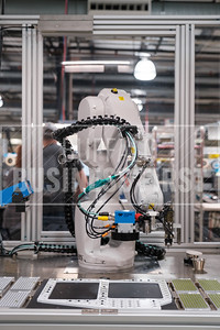 Astro, one of Astronics' robots does repetitive tasks like glueing led inserts into their products.