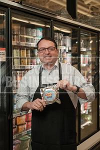 Chris Boyle, category manager, Lexington Co-op, holds up a Churn ice cream sandwich