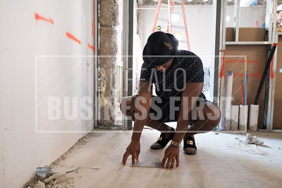Darian Bryan picks out tile for his new restaurant at the Millrace Commons.