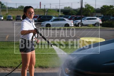 Aleen Tran sprays a car to Royal Car Wash's Transit location.
