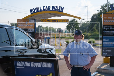 Justin Bell welcomes a car to Royal Car Wash's Transit location.