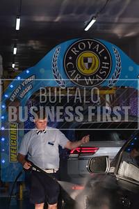 Zach Seiber sprays a vehicle at Royal Car Wash's Transit location.