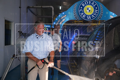 Anthony Daniele, co-owner, Royal Car Wash, sprays a car at the company's Transit Road location.