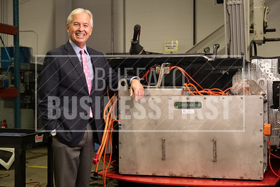 CEO for the Western New York Impact Investment Fund Tom Quinn rests his arm on a green machine e240 battery inside Viridi Parente, one of the funds investments. Viridi Parente is a East Delavan Avenue based lithium ion battery manufacturer that aims to replace diesel engines with its tech.
