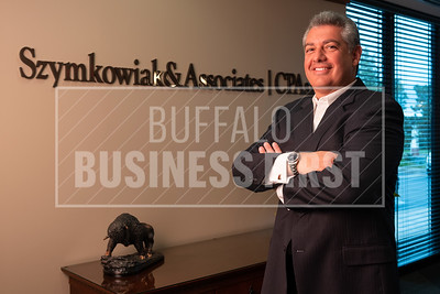 Joe Falbo, CPA, in the lobby of Szymkowiak & Associates CPAs. Falbo, a national CPA board member recently voted to allow non-CPAs to earn a business valuation credential.