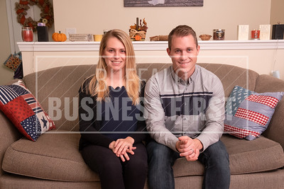 Brandee and Drew Mencer in their Orchard Park home. Brandee  graduated Niagara University with close to $55,000 in debt. With the help of a finacial planner and her husband she paid it off in 2016.