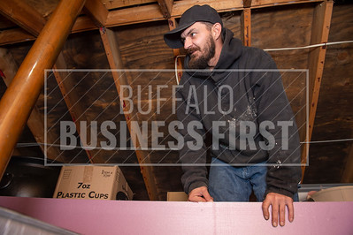 Supportive Services worker Tony Muschaweck  carries insulating foam board for one of the non-profit's weatherization projects.