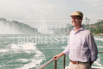 Christopher Glynn, president, Maid of the Mist, rides on one of the company's new electric boats
