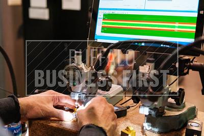 Bill Zielinski inspects an insert at North American Carbide.