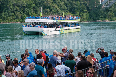 Customers wait on line for one of Maid of the Mist's new electric boats