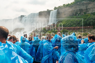 Customers ride on one of Maid of the Mist's new electric boats