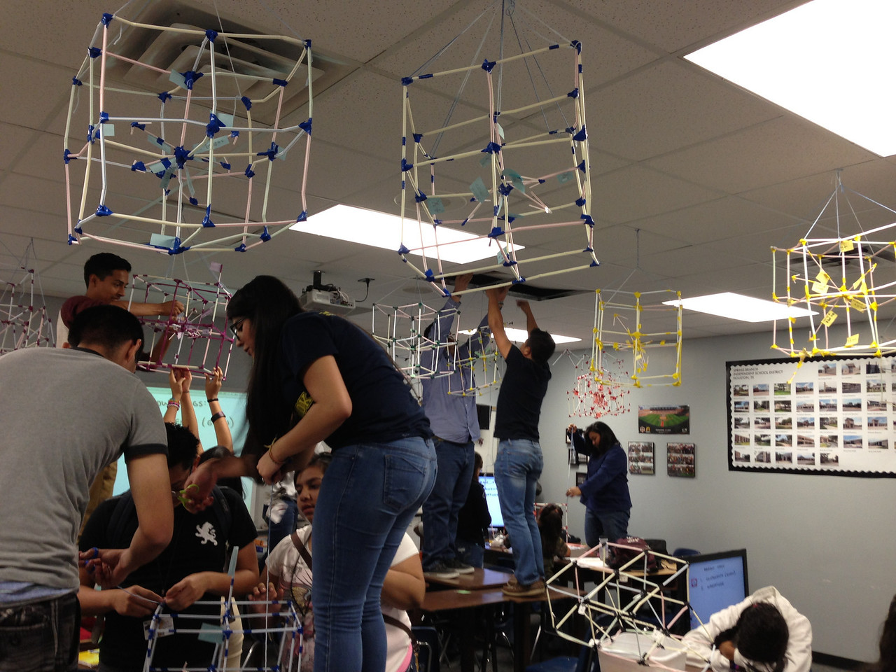 Students at Northbrook High took learning in-hand as they transformed straws into 3-D cubes as part of a classroom exercise. <br /> <br /> The project was a fun and interactive way to explore the concept of space.