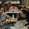 Alexander Giglio ('20) laughs with his partner, Rebecca Chen ('20), during the Jane Street Electronic Trading Challenge early Sunday morning. Jane Street hosted this 13 hour challenge in the SOCH for students to compete against each other by simulating market events.
