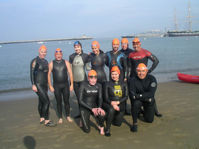 Water World Swim Winter regulars. Lisa, Paul, Michelle, Kristen, Coach Richard, Donald, Coach George, (Kneeled) Nina, Cande, Al