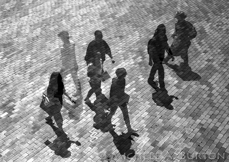Students and visitors cross University of Washington's Red Square in this multiple exposure image, which was created in camera with three separate exposures.
