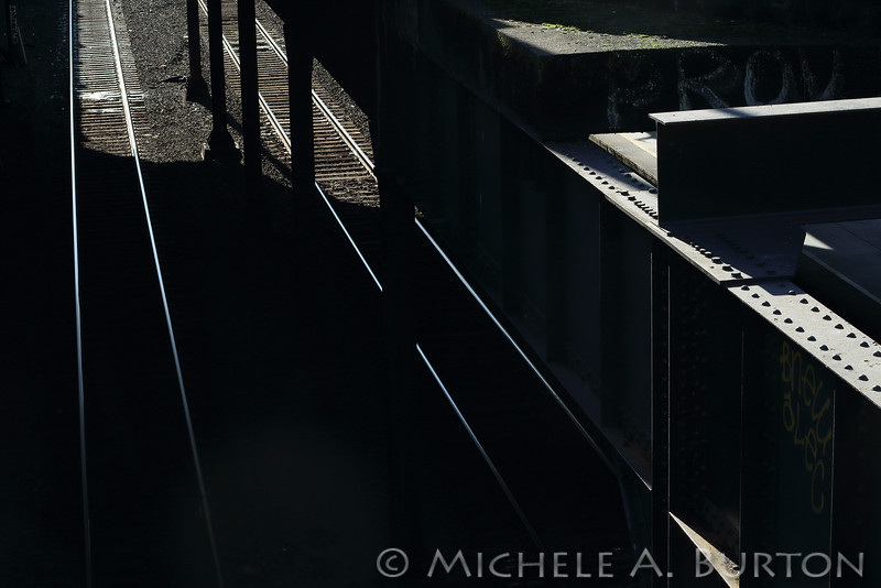 Midday sun illuminates the railroad tracks at King Street Station in Seattle, Washington