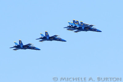 The Navy's Blue Angel flight demonstration squadron flies above the skies of Seattle, WA during the 2016 Seafair celebration  Stop Action shutter speed Sports Photography