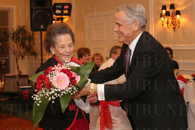 Honoree Barbara Cox received flowers from Dr. Ken Henderson.